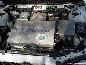 "The 50-kW controller takes in 300 volts DC and produces 240 volts AC, three-phase. The box that says ""U.S. Electricar"" is the controller."