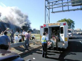 Medical personnel place an injured person into an ambulance outside the Pentagon, Arlington, VA, Sept. 11, 2001.