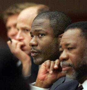Accused courthouse gunman Brian Nichols listens to testimony from the defense table on March 29, 2006, at the Fulton County Courthouse in Atlanta, Georgia.