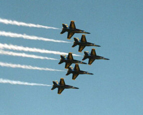 The Blue Angels streak by at an air show.