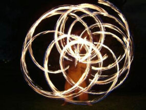 Spinning poi requires strength, flexibility and centrifugal force.