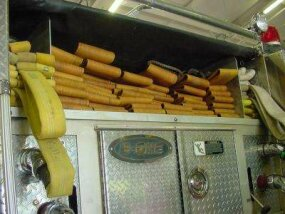 The wide yellow hose in back carries water from the hydrant to the fire engine.