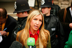 Heather Mills speaks to reporters after her divorce settlement with Sir Paul McCartney in March 2008.