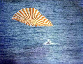 Gemini X splashes down into the ocean.