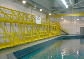 This gantry crane lets the Aquarium staff set up feeding stations for each species of fish in Ocean Voyager.