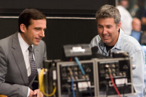 Steve Carell and Peter Segal review a scene.