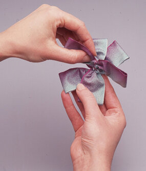 Create a pinwheel by stacking the bows.