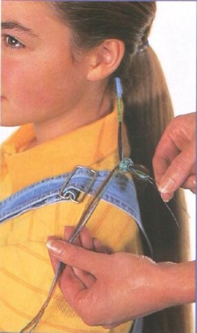 Thread a bead onto hair strand for extra style.