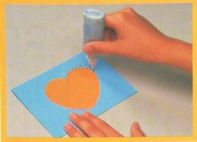 Use glitter paint to decorate the card.