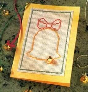 Use a glue gun to mount the gold bell on the card.
