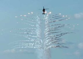 A U.S. Navy helicopter discharges countermeasure flares, similar to the flares and chaff commercial airplanes discharge.