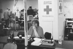 When deadly floods struck central and southern Texas in mid-October 1998, amateur radio operators from four states volunteered their time. Susan Manor, NF0T, is shown helping with communications at the New Braunfels Red Cross office.