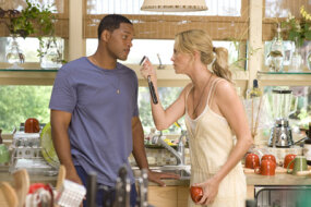 When Hancock (Will Smith, left), saves the life of a PR exec, he tries to return the favor by cleaning up the disgruntled superhero's public image, despite the fact that his wife, Mary (Charlize Theron, right) thinks that Hancock is a lost cause.