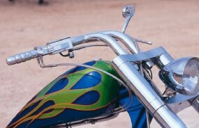 The envious tank and custom handlebars of the Hard Tail Chopper.