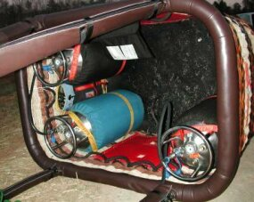 The basket holds the passengers, propane tanks and navigation equipment.