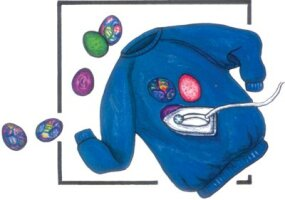 Adhere the fabric eggs to the sweatshirt.