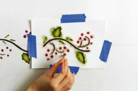 Use berry-red paint for the stencil's berries.