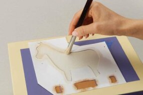 Stencil the horse's body with a 5/8-inch brush.
