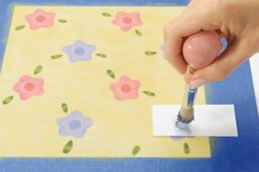 Stencil a circular dab of color inside each flower.