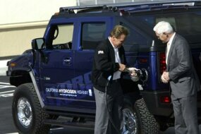 California governor and Humvee fan Arnold Schwarzenegger fuels up a hydrogen-powered Hummer.