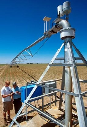 Ryan Younkin and Dale Heermann download data about the movement of a center-pivot irrigation system to find out the amount of water and time it took to irrigate an area.