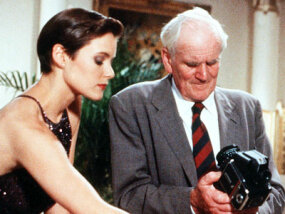"Carey Lowell as Bond Girl Pam Bouvier and Desmond Llewelyn as the original ""Q"" in the 1989 film ""License to Kill"""