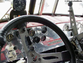 Hand-fabricated dashboard in a stock 1985 Peterbilt cab. Above the steering wheel is a zero to 300-mph airspeed indicator.
