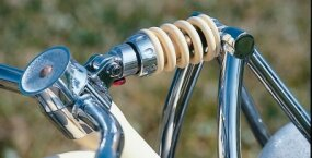 Solid forks pivot at the base of the Johnny Walker's frame neck, compressing a spring mounted to the top of the neck. A similar design was used on bicycles of the 1950s and 1960s.