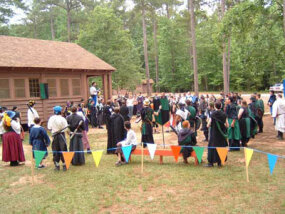 Players congregate outside the lodge at a LARP venue.