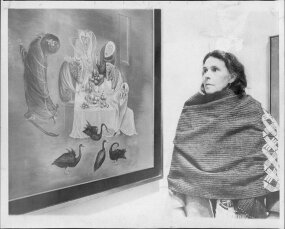 mexican artist leonora carrington in front of a painting