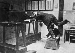An early method of measuring the feet of criminals, which was part of the Bertillon method used by the police force in Paris.