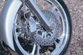 Dual front disc brakes are a welcome sight on a chopper with 124 cubic inches of power. Note the duplication of the wheel pattern in the disc hub.