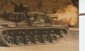 An M-60 Main Battle Tank fires its 105mm main gun.