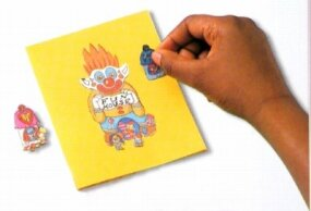 Cut out pictures and glue them to the front of the colored paper greeting card.