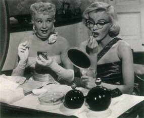 "Pola, the desperately nearsighted character played by Marilyn, declares, ""Men aren't attentive to girls who wear glasses."" Pola's insistence on leaving her glasses in her handbag provided Marilyn with opportunities to demonstrate her flair for physical comedy."