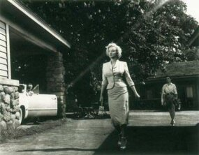 "The variety of form-fitting outfits worn by Marilyn in Niagaratook on added dimension when the star swung into the famous ""Monroe walk."""