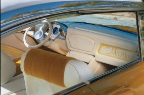 The interior of the Marquis is done in gold and white fabric and features a full-length center console.