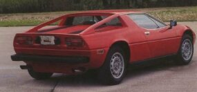 "The Giugiaro-styled V-6 Maserati Merak looked much like the V-8 Maserati Bora but had a flat deck and ""flying buttresses."""