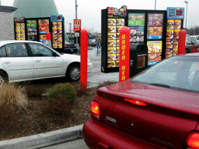 Modern drive-thrus incorporate displays to verify orders and some even have two order stations to speed up the process.
