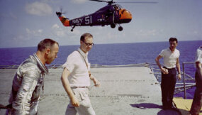 Alan Shepard during recovery (top) and on-board the carrier after his flight