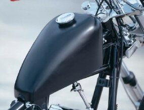 "Classic ""peanut"" fuel tank of the Model P                                                              chopper is painted flat black."