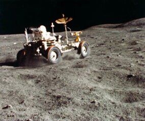 A 16mm film frame of astronaut John Young driving around the surface of the moon. Did NASA slow down footage of the moon landings to simulate weightlessness?