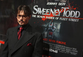 johnny depp actor in front of sweeney todd poster