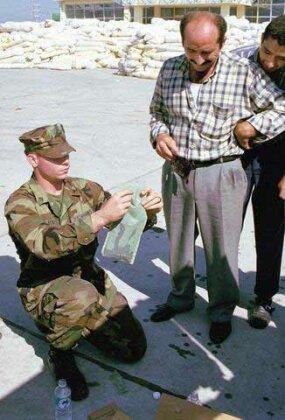 A Marine demonstrates a flameless heater.