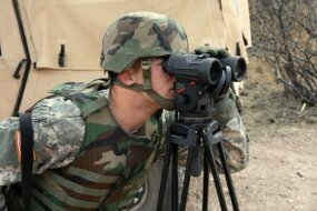 A Tennessee Army National Guard Soldier, who is not being identified for security reasons, uses binoculars to spot signs of illegal activity along the U.S. border with Mexico.