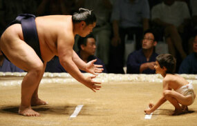 Which person in this ring will be harder to move? The sumo wrestler or the little boy?