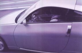 The vertical door handle is a distinctive 350Z feature.
