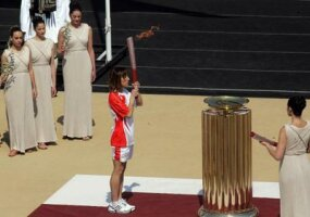 The last Torchbearer, Greece's Olympic silver medalist Chrysopygi Devertzi holds the Olympic torch at the Panathinaikon stadium during the handover ceremony to China on March 30, 2008.