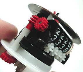 The output of the last worm gear drives a shaft that turns the tenth-of-a-mile indicator.