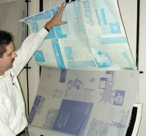 """A blue-line print is made from """"stripped-up"""" negatives and is used to check image position before printing."""